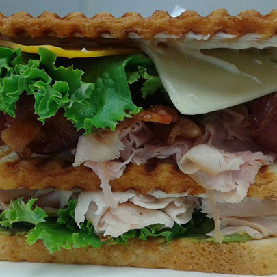 Club sandwich clubhouse sandwich on toasted bread sliced turkey bacon lettuce tomato mayonnaise